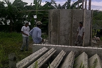 joyland-water-tank-waiting for cement to cure.jpg